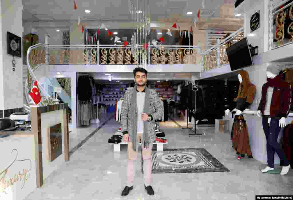 "Owner of a luxury clothes shop Sohail Ataie, 22. ""We are tired of war. What we want is peace, to live a better life."""