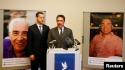 Lawyer Jared Genser and Babak Namazi, the brother and son of two prisoners in Iran, who have been sentenced to lengthy prison terms in Iran, address the media in Vienna, April 25, 2017