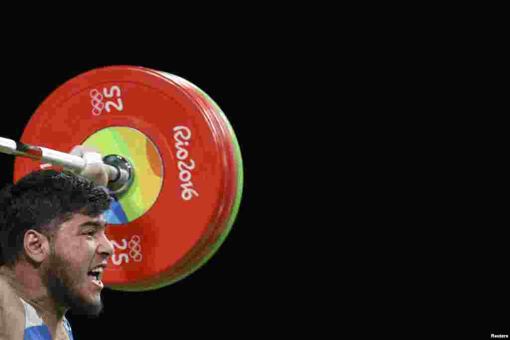 Izzat Artykov of Kyrgyzstan competes in the men's 69-kilogram weightlifting final in which he won a bronze medal.