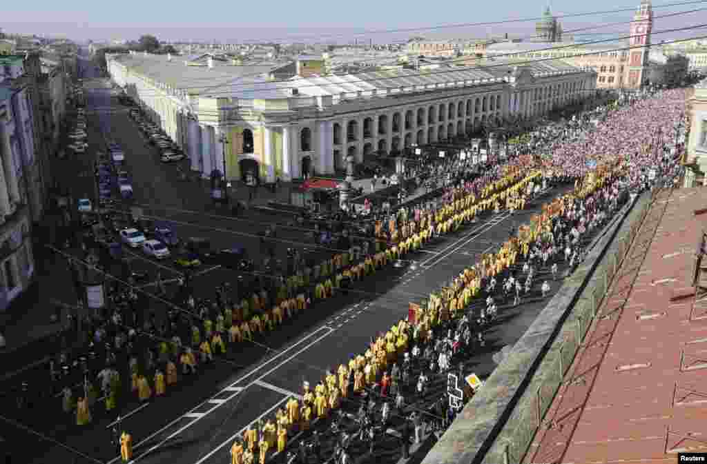 Russian Orthodox believers take part in a September 12 procession along St. Petersburg's Nevsky Prospect to mark the 300th anniversary of the city's Aleksandr Nevsky Monastery.