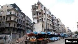 Многоэтажные дома в Алеппо, разрушенные в результате авиаударов российских ВВС. Сирия, 10 февраля 2016 года.