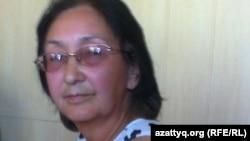 Зинаида Мухортова өзін күштеп емдеуге қатысты сот отырысында. Балқаш, 16 тамыз 2013 жыл.
