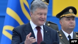 "Ukrainian President Petro Poroshenko speaks during Independence Day celebrations in Kyiv on August 24: ""The enemy has failed...to bring Ukraine to its knees,"" he said."