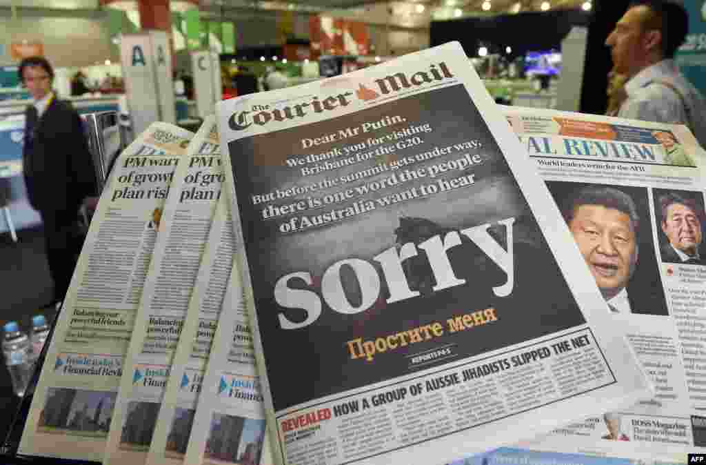 The front page of a local newspaper in Brisbane calls on Russian President Vladimir Putin to apologize for the downing of Malaysia Airlines Flight 17 as the Russian president prepared to arrive for a G20 summit. After pointed criticism from other G20 leaders, Putin eventually left the event early, suggesting he needed sleep. (AFP/William West)