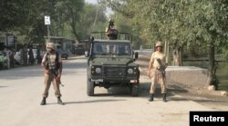 FILE: Army soldiers stand guard in Khyber tribal district.