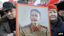 Russian Communist Party supporters hold a portrait of Soviet leader Josef Stalin at rally in Moscow in February.