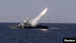 A medium-range missile is test-fired by Iran near the Strait of Hormuz in 2012.