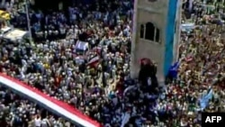 An image grab taken from footage uploaded on YouTube shows hundreds of thousands of Syrian antigovernment protesters flooding the streets of the central city of Hama on July 1.
