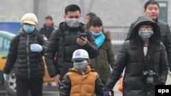Башкала Пекинда битлексез йөреп булмый. 2015 елның 15 гыйнвар фотосы