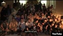 Сирияға жиһадқа барған қазақтар екенін мәлімдеп отырған адамдар. (YouTube видеосынан скриншот)