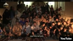 Скриншот с видеозаписи о группе «прибывших в Сирию казахских джихадистов», опубликованной в октябре 2013 года.