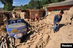 Після землетрусу, місто Дінсі, провінція Ґаньсу, 22 липня 2013 року