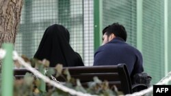 An Iranian couple sit in a park in the capital Tehran on March 14, 2017. File photo