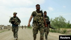 Members of an Afghan commando unit arrive at the Qala-i-Zal, a district in the northeastern to the northwest of Kunduz, May 16, 2017