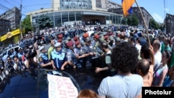 Armenia -- Dozens of people demonstrate in Yerevan as the Public Services Regulatory Commission formally raises electricity prices by 10 percent, 1Jul2014.