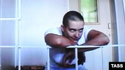 Ukrainian military pilot Nadiya Savchenko is seen on a screen during a video link at a hearing into her appeal at the Voronezh regional court in July.
