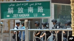 Chinese Special Police Corps troops stand guard near the site of an attack in Kashgar in Xinjiang in August 2011 that was blamed on Islamic extremists.