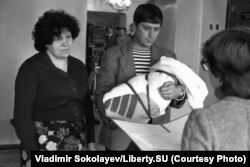 A registration ceremony for a newborn baby in October 1983