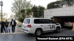 UN vehicles carrying the fact-finding team of the Organization for the Prohibition of Chemical Weapons arrive at the Four Seasons hotel in Damascus on April 14.