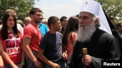 Patriarch Irinej (right) of Serbia seen here near the Kosovo capital, Pristina, in June