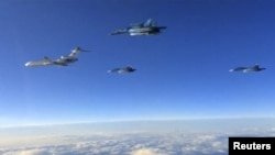 Российские военные самолеты, возвращающиеся из Сирии в Россию. 15 марта 2016 года.