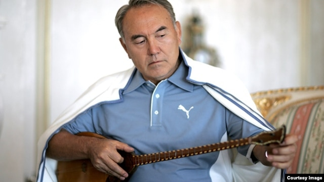 Kazakh President Nursultan Nazarbaev playing the dombra, a national instrument of Kazakhstan.