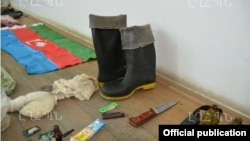 Nagorno-Karabakh - Weapons, ammunition and an Azerbaijani flag which the Karabakh Armenian military says were confiscated from an Azerbaijani man arrested arrested in Kelbajar, 10Jul2014.