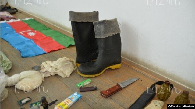 Nagorno-Karabakh - Weapons, ammunition and an Azerbaijani flag which the Karabakh Armenian military says were confiscated from an arrested member of an Azerbaijani commando unit, 10Jul2014.