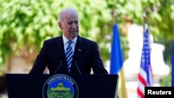 U.S. Vice President Joe Biden addresses a joint media briefing with Romanian President Traian Basescu in Bucharest on May 21.