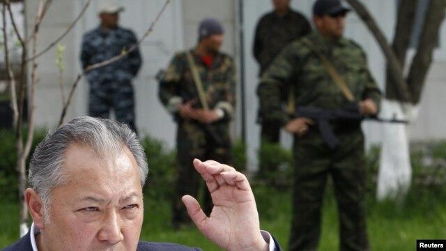 Ousted Kyrgyz President Kurmanbek Bakiev speaks to reporters in Teyit on April 13.