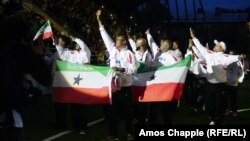 The Somaliland soccer team receive a roaring welcome from the crowd at the Conifa World Football Cup opening ceremony in Abkhazia.