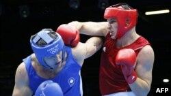 Аса ауыр салмақта бокстан олимпиаданың қола жүлдегері атанған Иван Дычко (оң жақта). Лондон, 6 тамыз 2012 жыл.