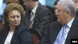 Communist leader Vladimir Voronin (right) speaks to former Prime Minister Zinaida Grecianii before a presidential vote in Chisinau on December 7.