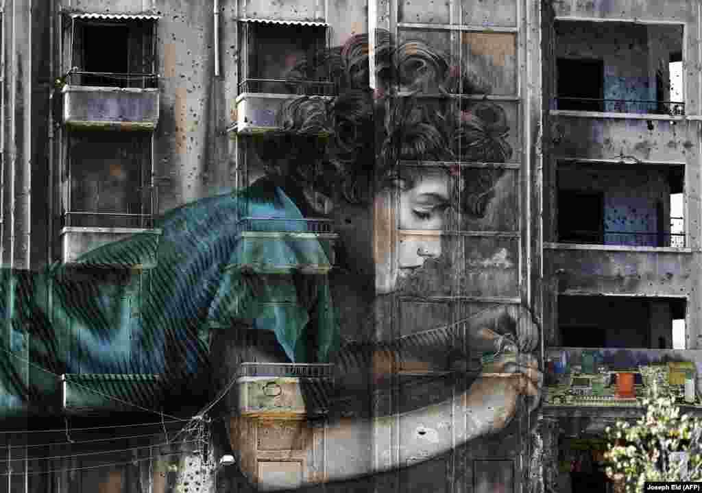 Лібан: графіці на будынку ў Бэйруце. (AFP/Joseph Eid)