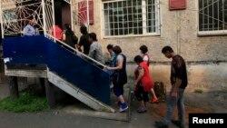 Красноярскта кармалган мигранттар. 7-август, 2013-жыл