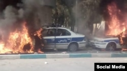 Protesters in Shiraz set police cars on fire, November 16, 2019.