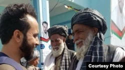 Javid Faisal (L) is campaigning become a member of the Wolesi Jirga, lower house of the Afghan parliament.