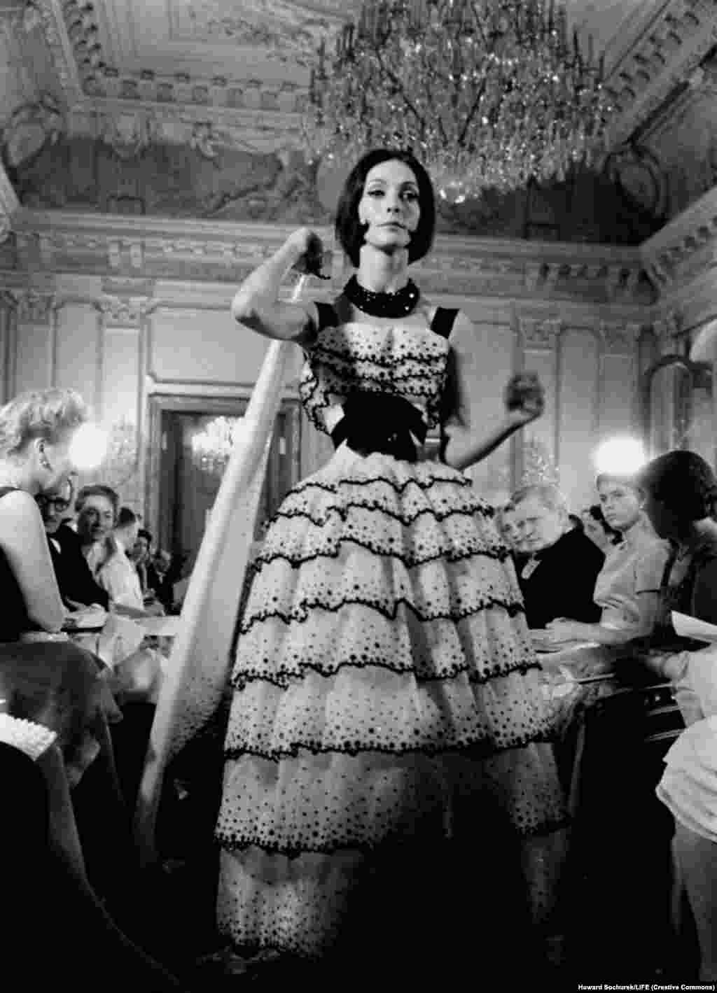 Kouka Denis modeling a Dior evening gown. The fashion house was headed at the time by a 23-year-old Yves Saint Laurent, who would go on to found his own company.
