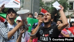 Syrian student Mughira al-Sharif demonstrates against the Assad regime in front of the Syrian Consulate in Istanbul.