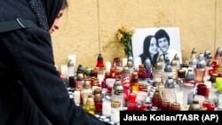 People light candles in tribute to murdered Slovak investigative reporter Jan Kuciak, 27, and his fiancee, Martina, 27, in Bratislava on February 27.
