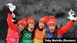 Беларускія біятляністкі на алімпійскім п'едэстале