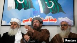 Taliban negotiators speak during a news conference in Islamabad on February 4, 2014