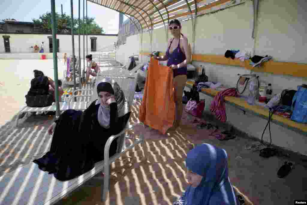 Young Salafi Muslim women spend time at a public women's beach in the Daghestani capital, Makhachkala.