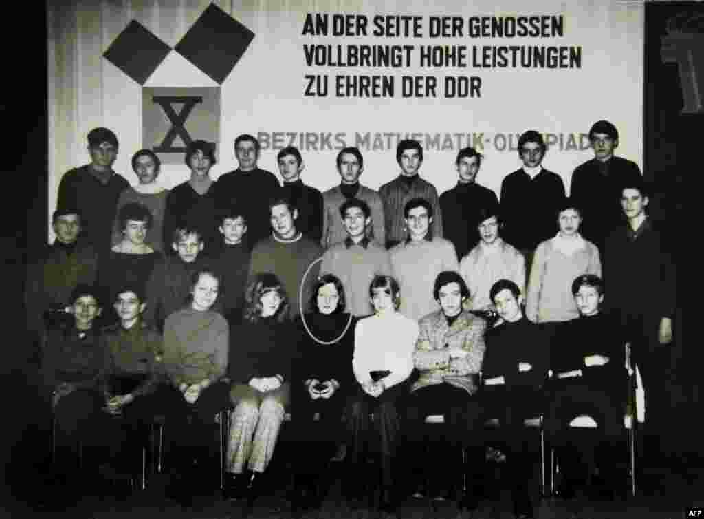 Angela Merkel-Kasner (first row, circled) poses for a group photo at the 1971 Mathematics Olympiad in the Neubrandenburg district in the northeastern town of Teterow, East Germany.