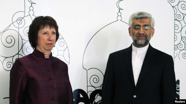 European Union foreign policy chief Catherine Ashton (left) with Iran's chief negotiator Said Jalili in Baghdad on May 23