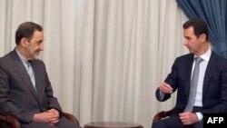 بشار اسد، رئیسجمهوری سوریه، (سمت راست) در دیدار با علیاکبر ولایتی، مشاور عالی رهبر جمهوری اسلامی