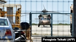 A Turkish military helicopter lands in the northern Greek city of Alexandroupolis with eight men on board who have requested political asylum after the attempted coup in Turkey, July 16, 2016.
