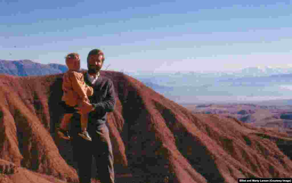 Dr. Elliot Larson holds his son near the ruins of Shari-gogola (city of tears), which was destroyed completely by Genghis Khan. The young doctor taught microbiology in the Nangrahar Faculty of Medicine in Jalalabad from 1970-74. Elliot returned to Afghanistan between 2005 and 2011 before being instructed to leave by the U.S. government.