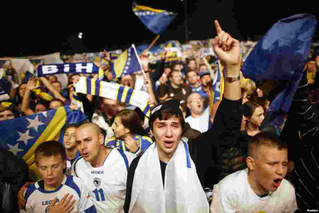Fans of Bosnia-Herzegovina's national soccer team celebrate their 2014 World Cup qualifying match victory over Lithuania, in Sarajevo. (Reuters/Dado Ruvic)