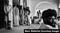 File photo of outside the front door of the late tribal leader Nawab Akbar Khan Bugti's home, several Bugti tribesmen stand guard, while others wait for an audience with their chieftain.